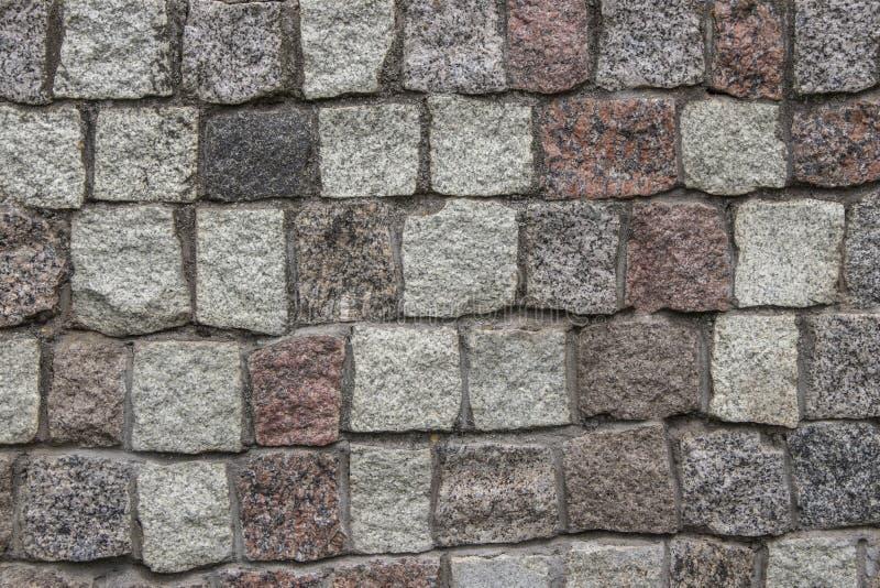 Pedra de construção cinzenta para pavimentar paredes e estradas Textura, fundo, pedra de pavimentação fotografia de stock