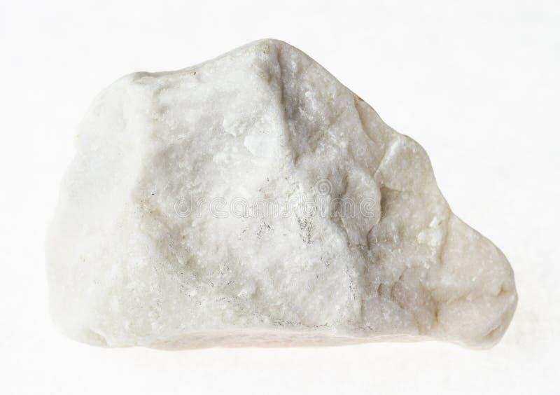pedra de mármore branca áspera no fundo branco imagens de stock royalty free