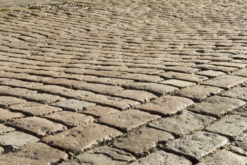Pedra de pavimentação na luz do por do sol foto de stock royalty free