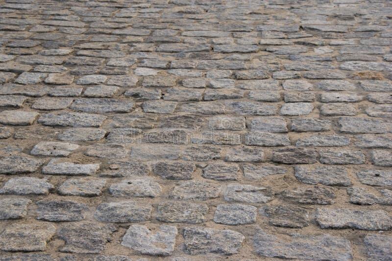 Pedra de pavimentação velha, fim do passeio do pavimento acima da foto foto de stock royalty free