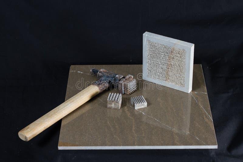 Pedra de Piacentina com ferramentas imagem de stock royalty free