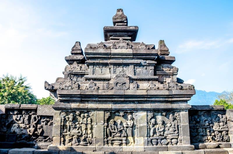 Pedra decorada com relevos de bas no templo de Borobudur em Yogyakarta, Java, Indonésia imagens de stock royalty free