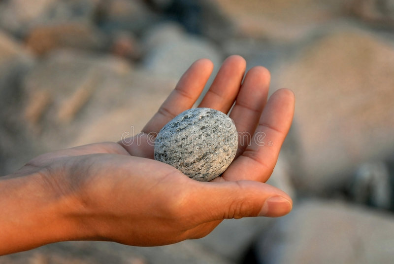 A pedra em minha mão imagens de stock royalty free