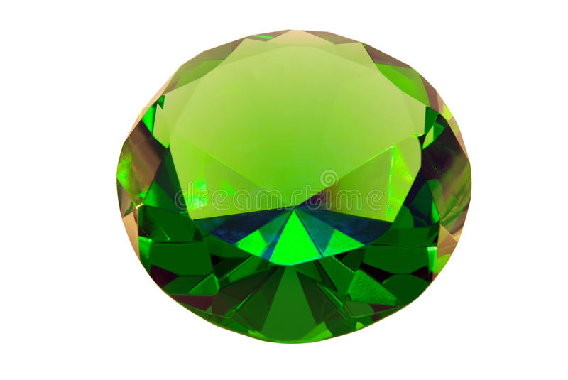 Pedra esmeralda verde em um fundo branco fotografia de stock