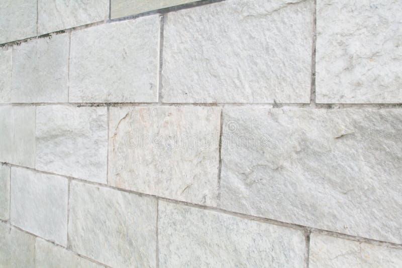 A pedra obstrui o fundo abstrato da textura da parede foto de stock