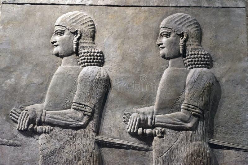 Pedra Sumerian antiga que cinzela na parede foto de stock royalty free