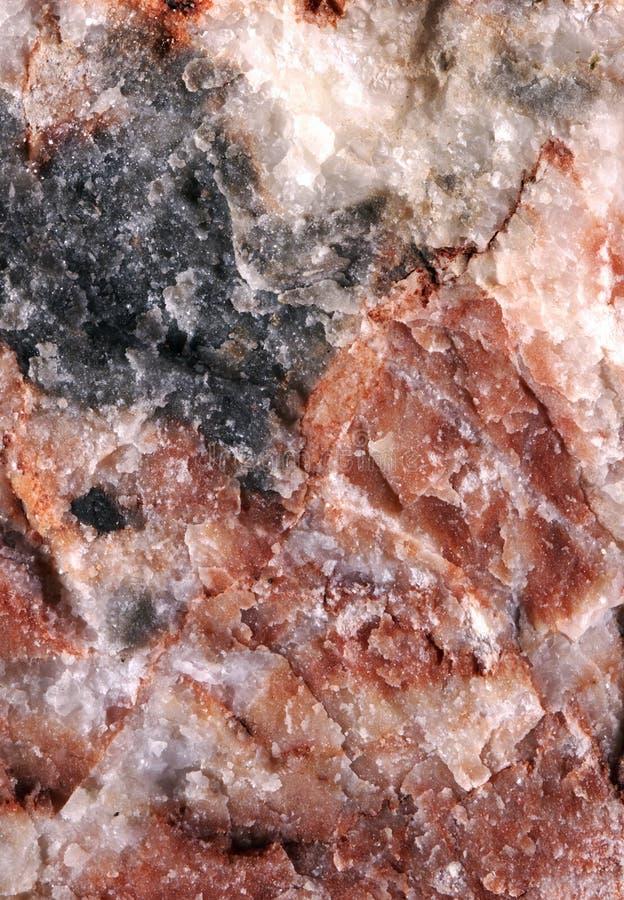 A pedra vermelha com preto e branco polvilha fotos de stock royalty free