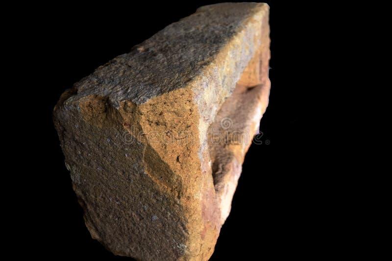 Pedra vermelha queimada com aspecto velho imagem de stock