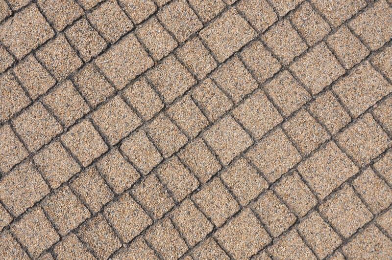 Pedras de pavimentação bege imagens de stock