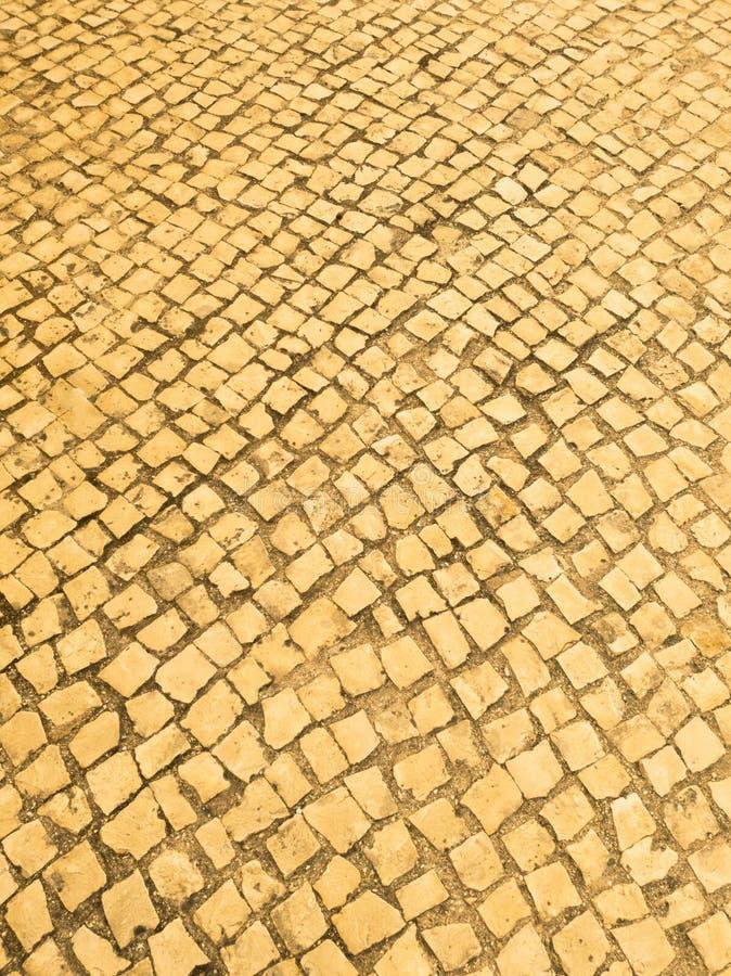 Pedras para calcetar atrativas, ásperas, amarelas fotos de stock