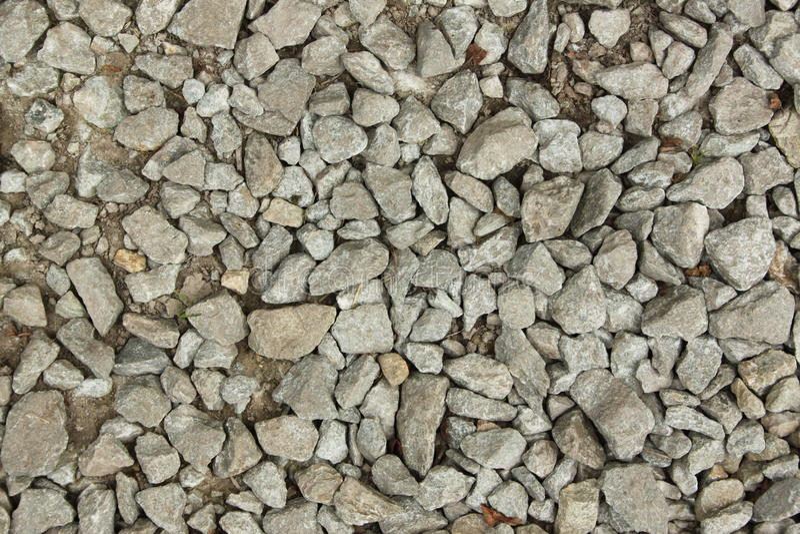 Pedras pequenas em uma terra com a areia para o fundo, projeto imagem de stock royalty free