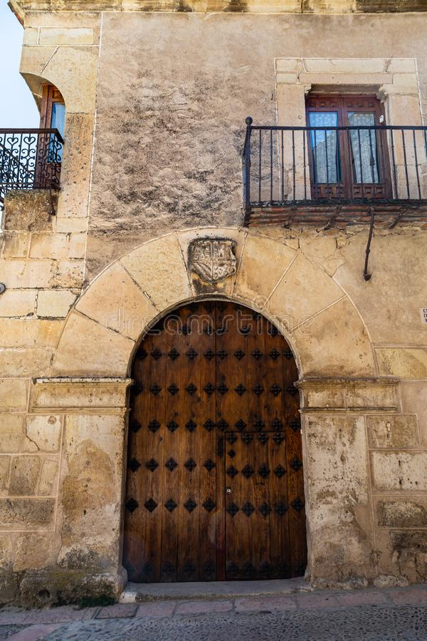 Pedraza, Castilla Y Leon, Spain: reinforced iron doorway with heraldic crest above. Pedraza is one of the best preserved medieval villages of Spain, not far stock photo