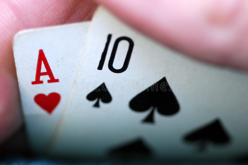 A Peek at 21. A peek at a Blackjack hand reveals a winning 21 royalty free stock image