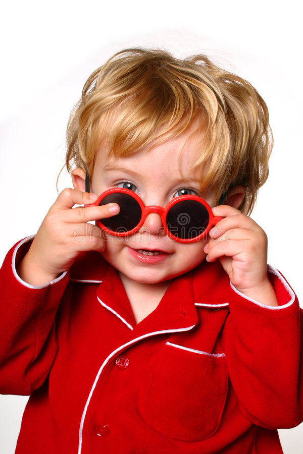 Peek a boo. Toddler peeking over a pair of red sunglasses royalty free stock image