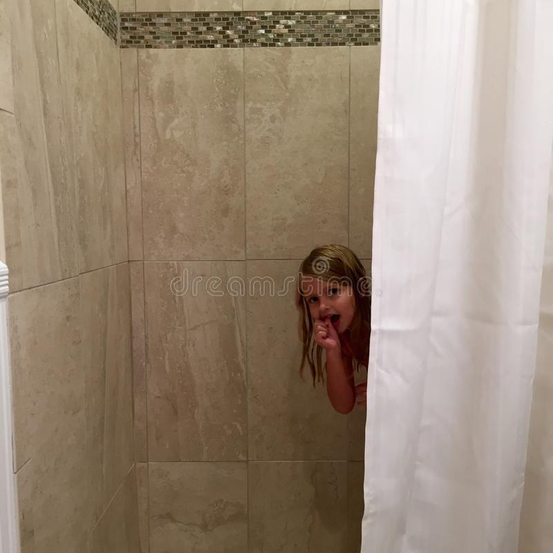 Peek a boo. In the shower royalty free stock photography