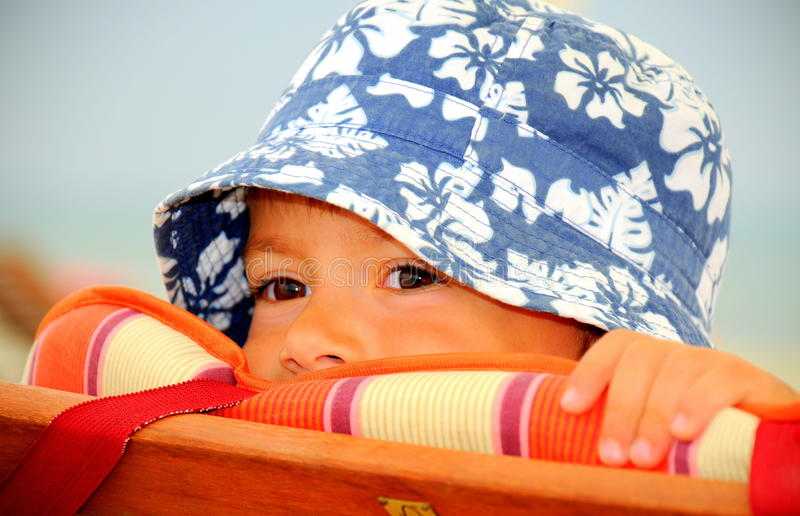 Peekaboo (cute kid hiding) stock images