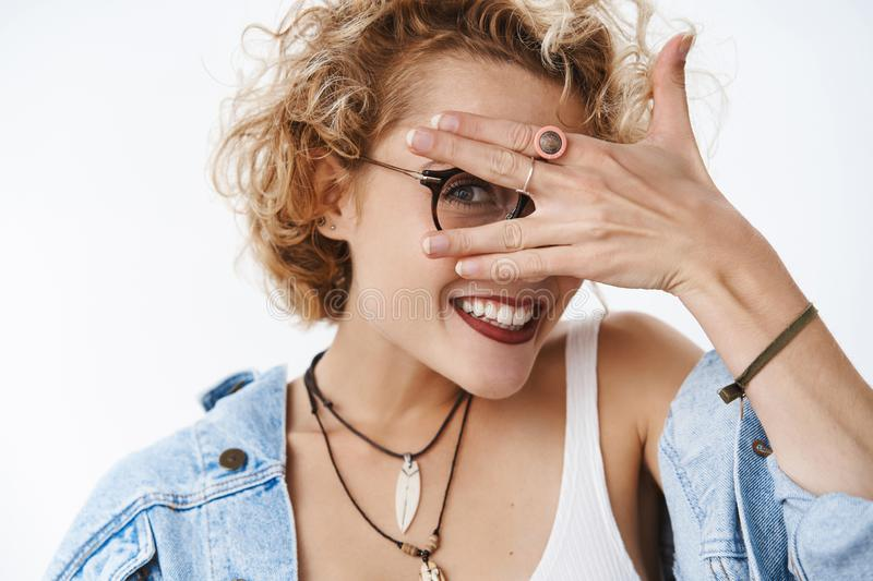 Peekaboo who there. Portrait of charismatic cute and playful girlfriend with stylish curly hairstyle wearing glasses and. Denim jacket close eyes with palm and stock photos