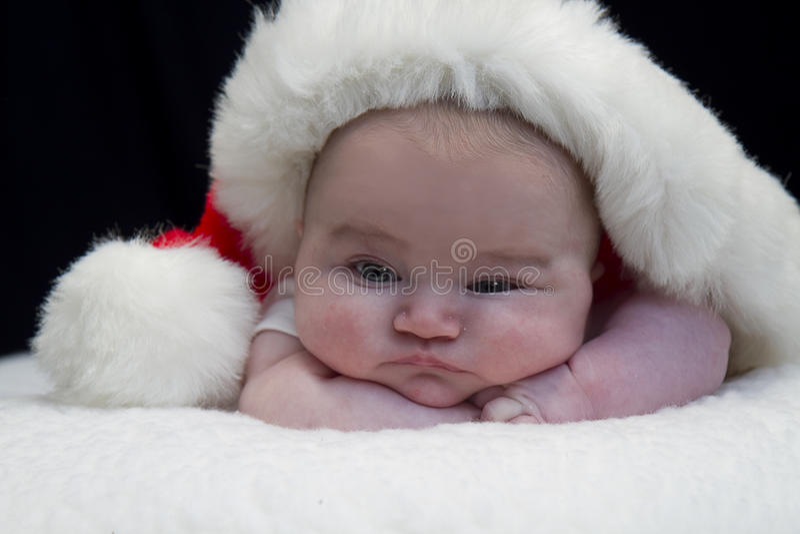 Peeking младенца Санты стоковые фото