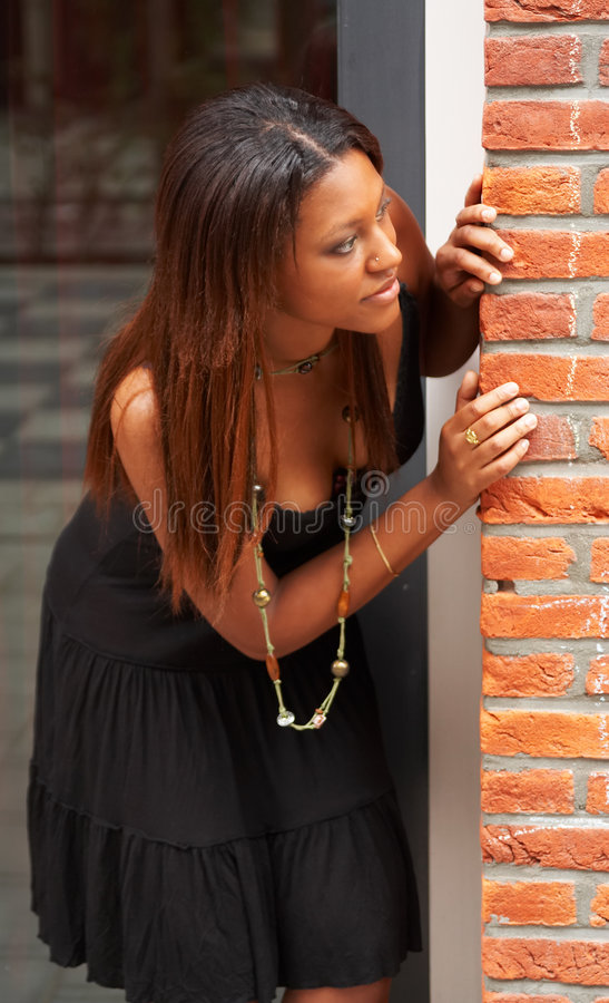 Download Peeking around stock photo. Image of black, hiding, brunette - 2731606