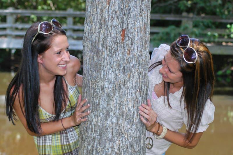 Download Peeking around a Tree stock photo. Image of female, dress - 6060340
