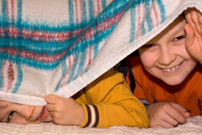 Peeking Boys Stock Images