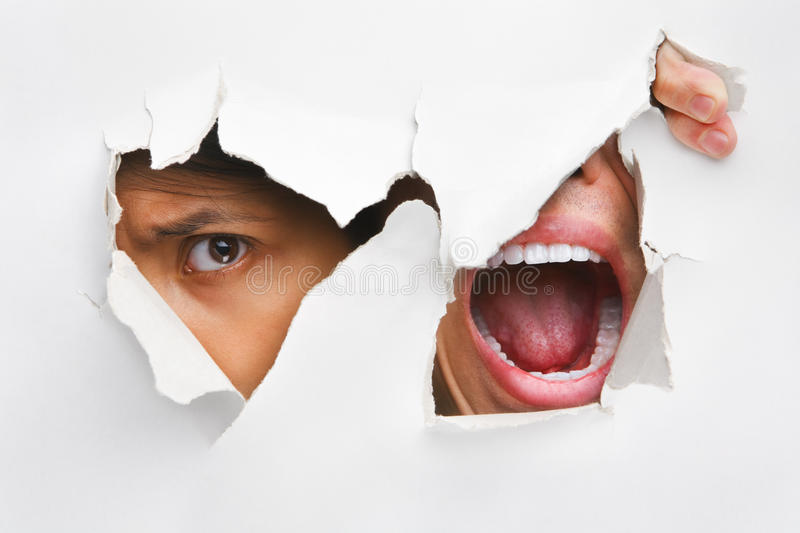 Download Peeking And Screaming From The Hole In Wall Stock Photo - Image: 10094150
