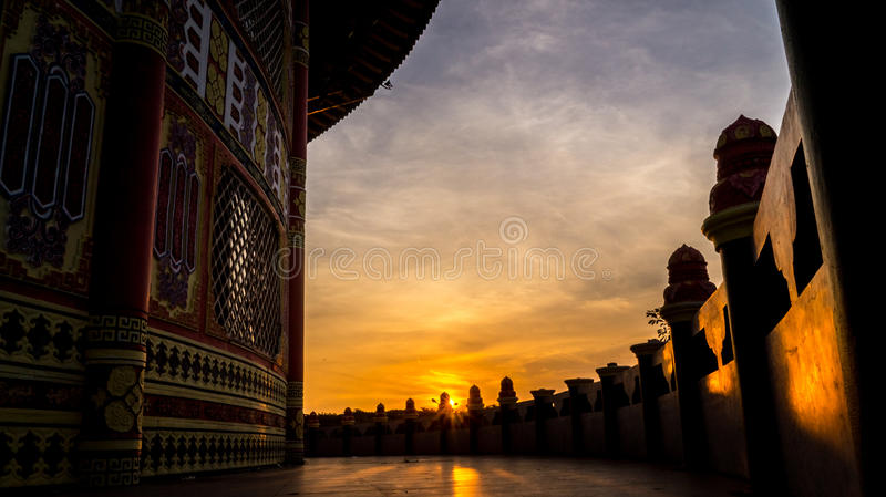 Peeking sunset from the pagoda royalty free stock images