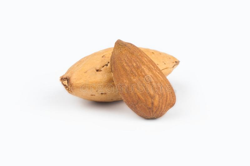 Peeled almond nut with shell isolated on white background. royalty free stock photography