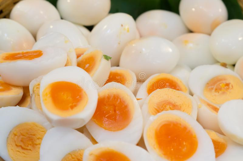 Peeled boiled eggs in both whole and half shape stock image