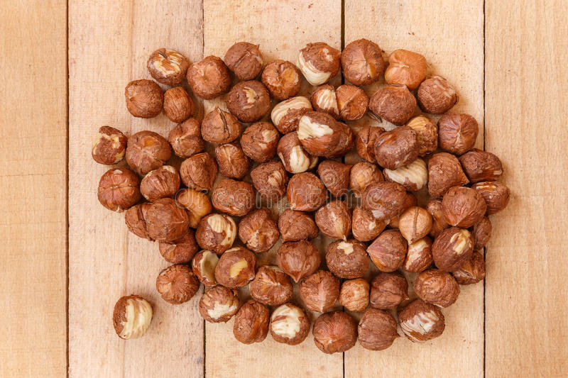 Peeled nuts on wooden boards stock photo