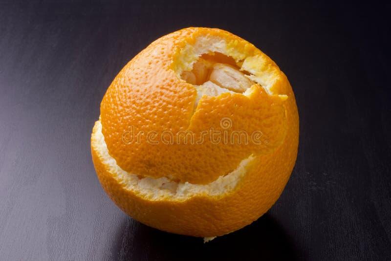 Peeled orange. Citrus. Orange with peel on a black surface stock image