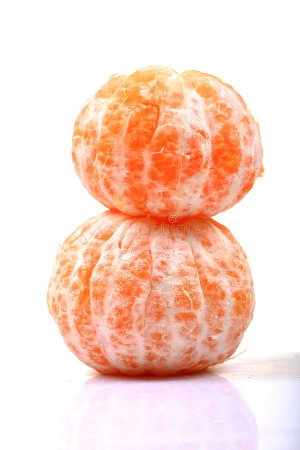 Peeled oranges. Isolated on white background royalty free stock images