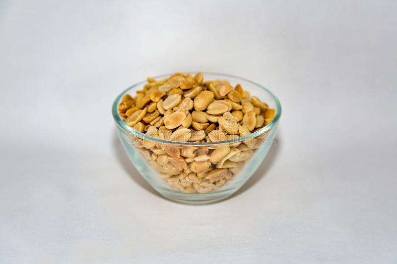 Peanuts in a glass bowl stock image