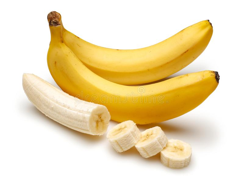 Peeled and sliced bananas isolated on white stock photo