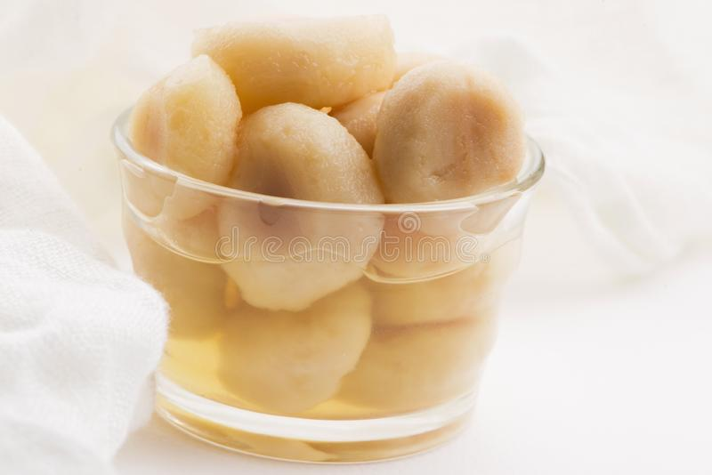 Peeled water chestnuts, tasty ingredients for a Chinese meal. Macro royalty free stock photography