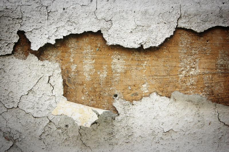 Peeled white stucco on cement wall royalty free stock image