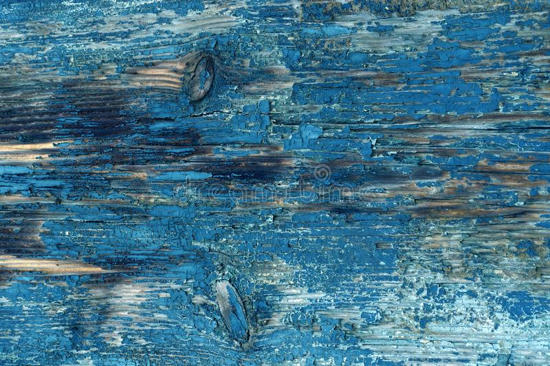 Peeling blue paint on an ancient wooden door royalty free stock photography