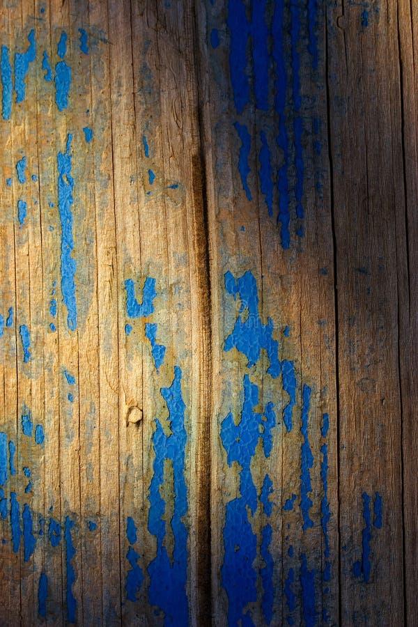 Peeling blue paint on wood stock images