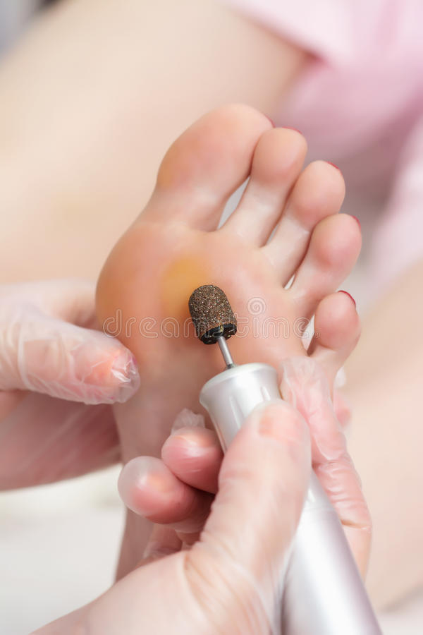 Free Peeling Feet Pedicure Procedure With Eletric Device In The Beau Royalty Free Stock Photo - 76382995