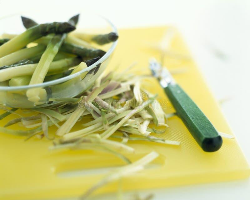 Peeling Green Asparagus Royalty Free Stock Photo