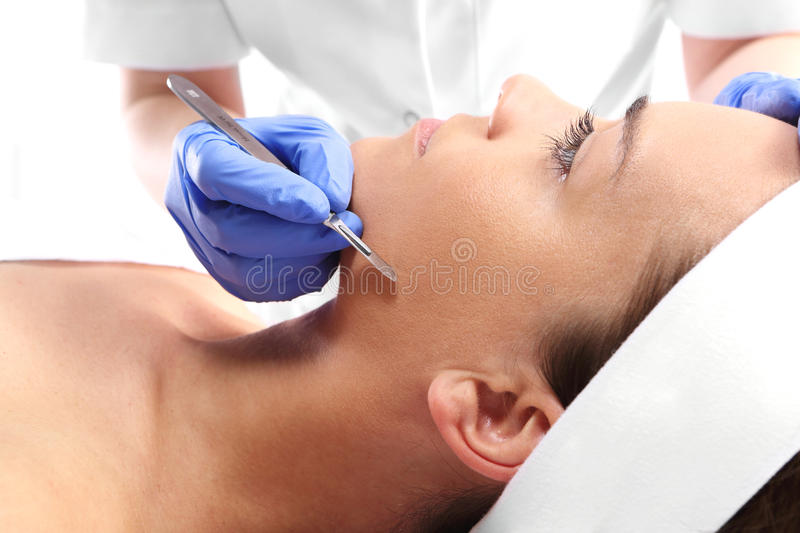 Peeling mechanical scalpel facelift royalty free stock photo