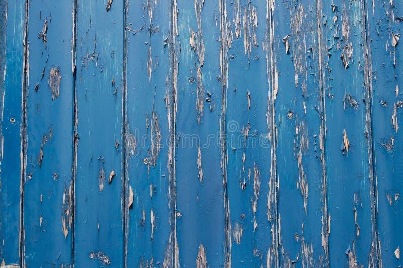 Peeling Paint On Blue Wooden Door stock photo