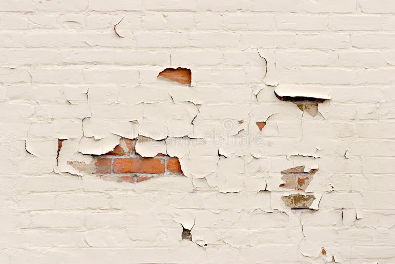 Peeling paint over brick wall stock image