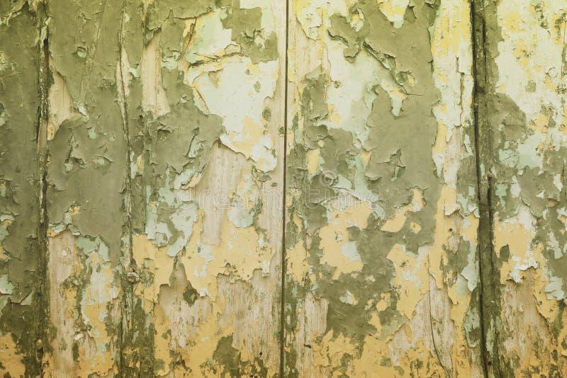 Peeling paint vintage texture. Grunge style old wooden door background stock photo