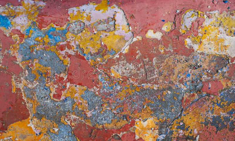 Peeling paint on wall seamless texture. Pattern of rustic blue grunge material. Peeling paint on wall grunge texture. Pattern of rustic red and yellow grunge royalty free stock photography
