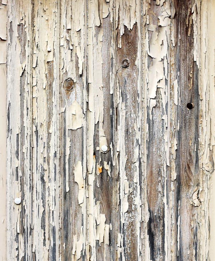 Peeling paint wooden surface. Peeling paint old wooden plank surface background stock photo