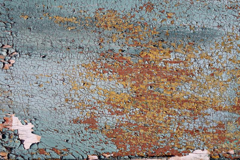 Multilayer paint. Peeling paint on a wooden surface. Texture of the old cracked paint. Cracked paint on a wooden surface stock photos