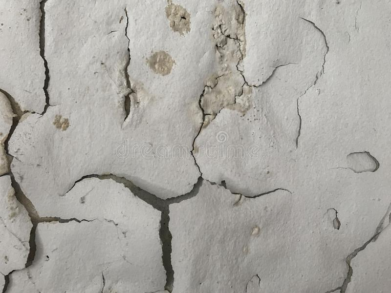 Peeling painted like human face on wall background royalty free stock images