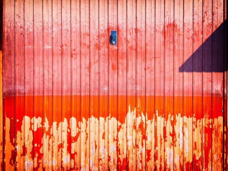 Peeling and weathered garage door royalty free stock photos