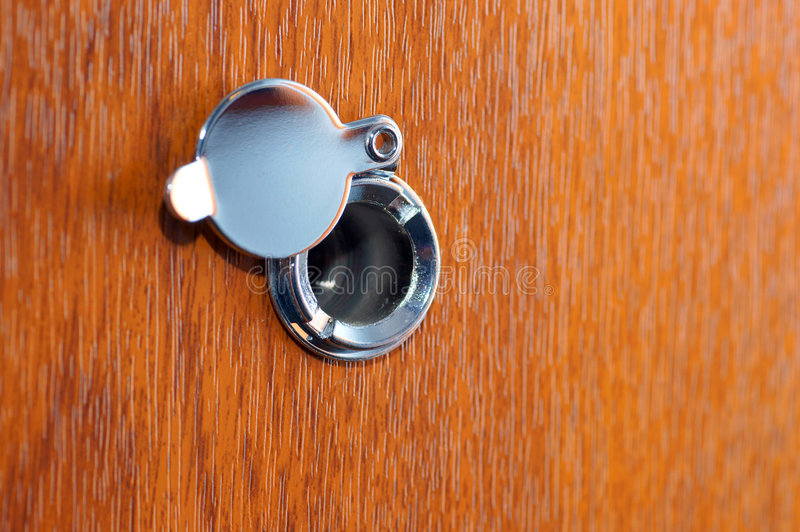 Peephole. On wooden door watching, wood royalty free stock image